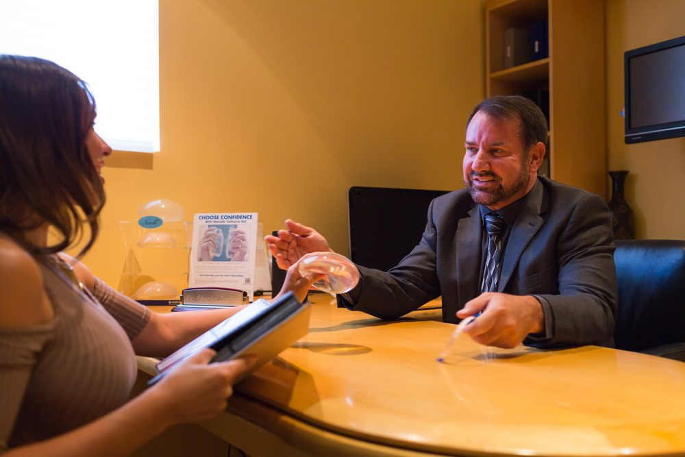 woman reviewing breast implant financing options at san diego body contouring