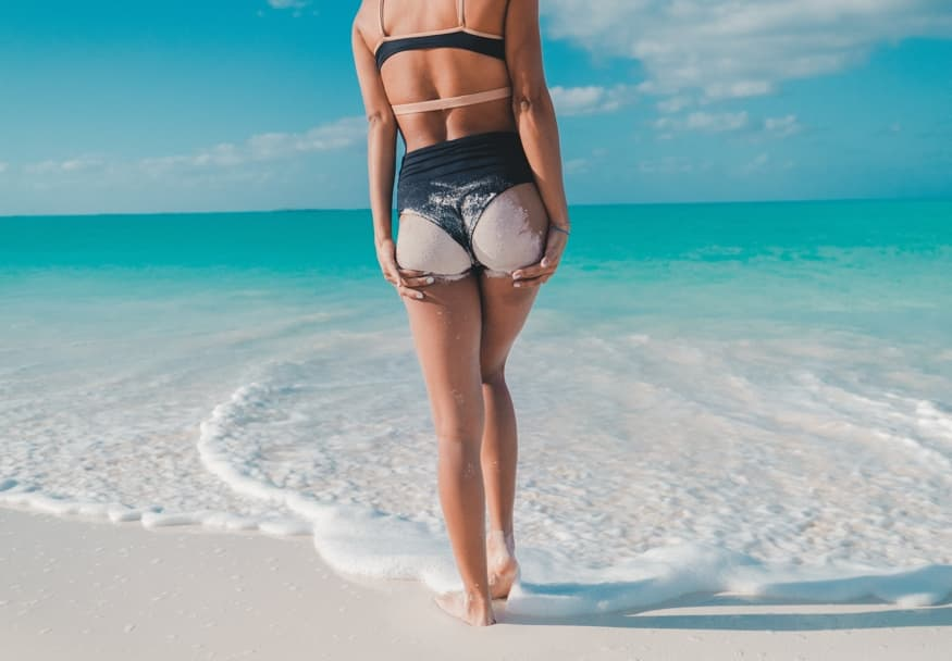 woman on beach who had cellulite procedure done